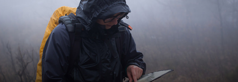 Hiker studying a map